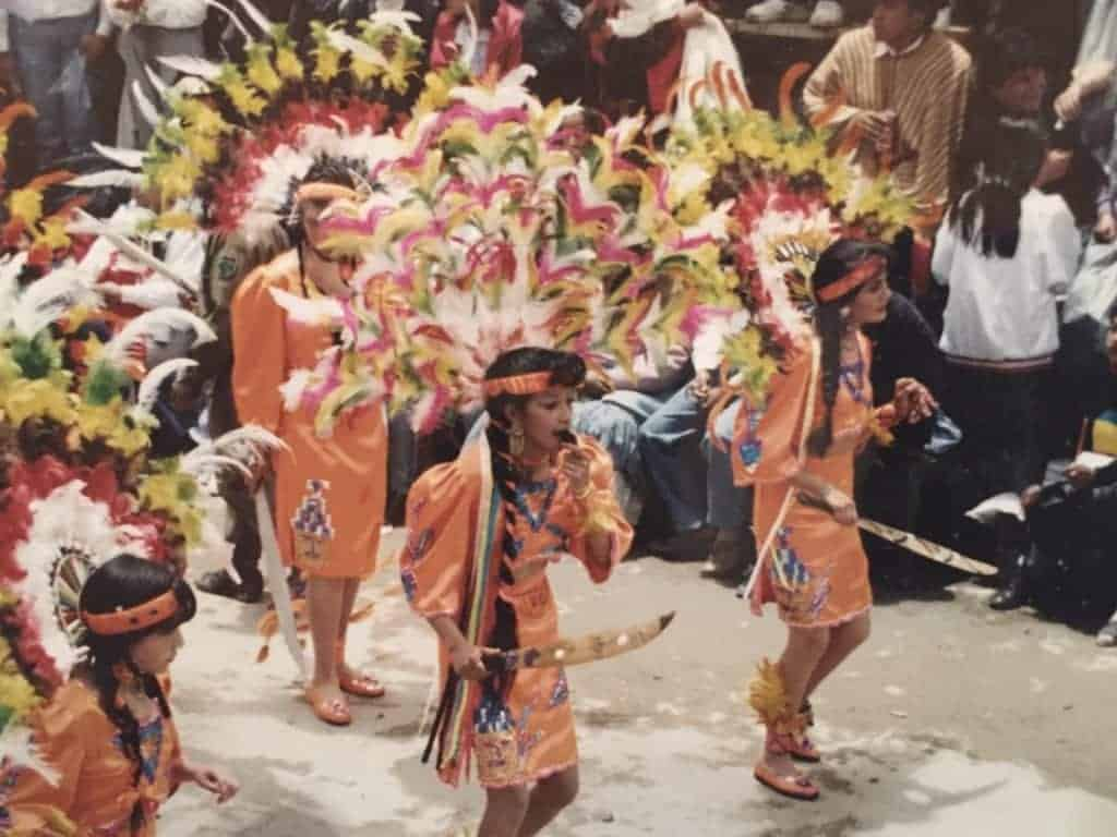 Procession of indigenous people in South America.